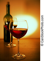 Red wine - Two glasses of red wine and wine bottle.