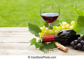 Red wine, wine bottle and grape