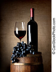 Red wine with barrel and grapes - Bottle of red wine, wine...