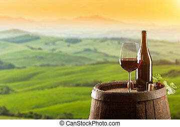 Red wine with barrel on vineyard in Italy