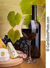 Red wine with grape and cheese snack