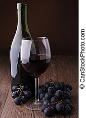 red wineglass and grape