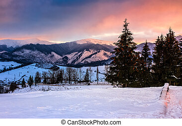 red winter sunset in mountains - mountains covered with snow...