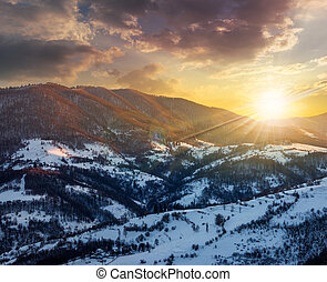 red winter sunset in mountains village