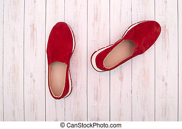 Red Women's sneakers on a wooden background