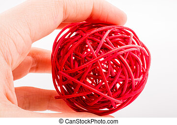 red wooden ball on a white background