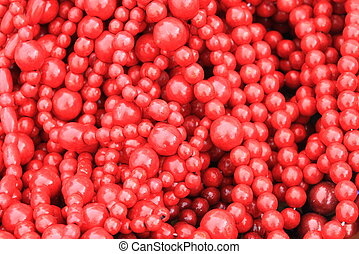 Red wooden beads as stylish red background with painted wood texture