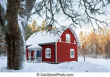 Red wooden cottage in Sweden - Traditional red painted...