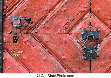 Red wooden door with rustic keyhole