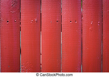 Red wooden fence close up background