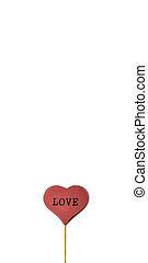 Red wooden heart on the white background with copy space. Love concept