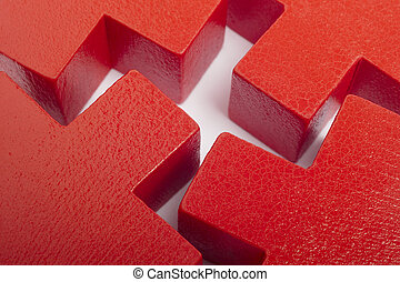 Red wooden toy pieces over a white background