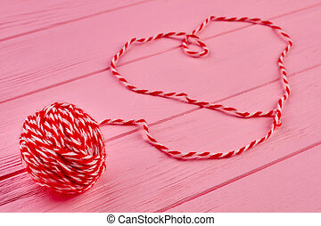 Red woolen ball of yarn.