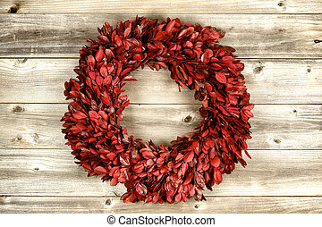 Red Wreath on vintage wood for the holidays