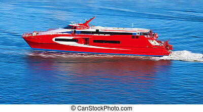 Red yacht with motion blur