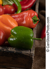 Red, yellow and green bell peppers.