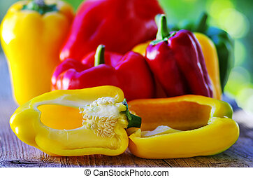 red, yellow and green pepper on table