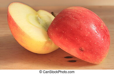 Red yellow apple with and slice wood background