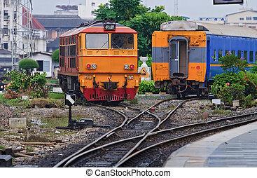 Red Yellow Diesel Engine Train locomotive approaching to Bangkok Railway Station Thailand