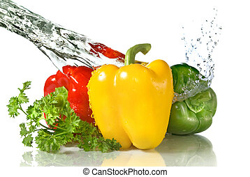 red, yellow, green pepper and parsley with water splash ...