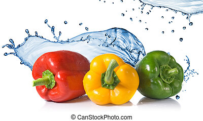red, yellow, green pepper with water splash