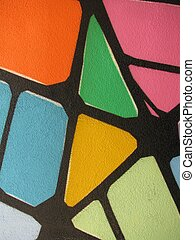 Red yellow orange pink green abstract wall paint.