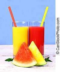 Red, yellow watermelon and juice with straw