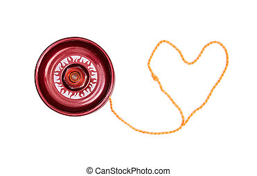 Red yoyo with heart-shaped twine on the white background.