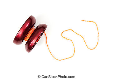Red yoyo with twine on the white background.
