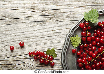 Redcurrant - Fresh redcurrant on wooden background close up