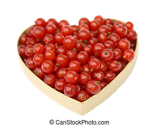 Redcurrants in heart shaped box, isolated on white background.