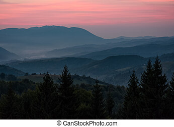 reddish sky at dawn in mountains - spectacular background of...