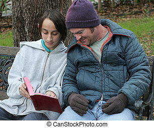 Redemption - A teen boy sharing the bible with a homeless...