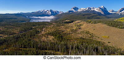 Redfish Lake in Idaho with fog aerial view - Fall colors in...