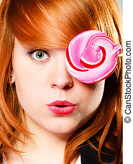 Redhair girl with pink lollipop - Closeup funny young woman...
