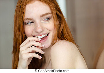 Redhair woman looking away - Closeup portrait of a redhair...