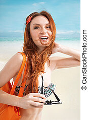 Redhair woman on beach