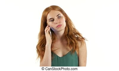 Redhaired girl talking on the phone. White background