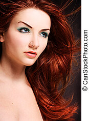 Redhead - A beauty shot of a young blue eyed woman with her...