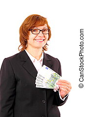 Redhead business woman holding money with Christmas snowflake