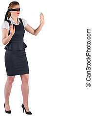 Redhead businesswoman in a blindfold on white background