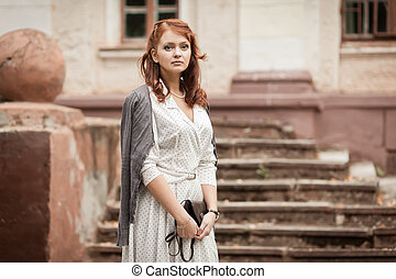 Redhead girl at park. Photo in old image style.