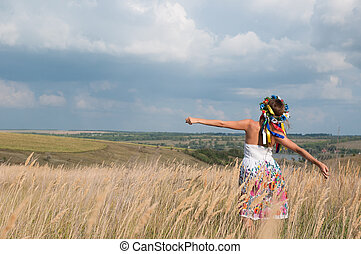 Redhead girl at spring wheat field