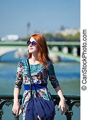 Redhead girl in city
