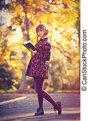 Redhead girl in glasses with book
