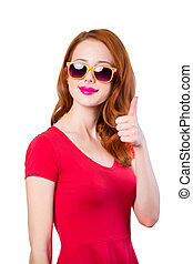 Redhead girl in red dress and sunglasses