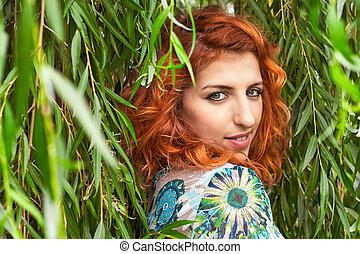 Redhead girl looking over her shoulder