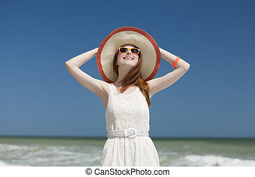 Redhead girl on the beack in spring time.