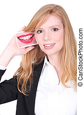 Redhead girl smiling with photo of a mouth