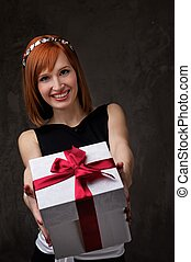 Redhead girl with a gift box.